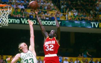 BOSTON, MA - CIRCA 1984: Lewis Lloyd #32 of the Houston Rockets shoots over Larry Bird #33 of the Boston Celtics during an NBA basketball game circa 1984 at The Boston Garden in Boston Massachusetts. Bird played for the Celtics from 1979-92. (Photo by Focus on Sport/Getty Images) *** Local Caption *** Larry Bird; Lewis Lloyd