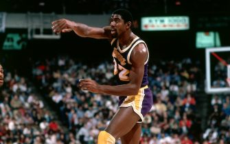 1983: Magic Johnson #32 of the Los Angeles Lakers makes a pass during an NBA game.  NOTE TO USER: User expressly acknowledges and agrees that, by downloading and/or using this Photograph, user is consenting to the terms and conditions of the Getty Images License Agreement.  Mandatory Copyright Notice: Copyright 1983 NBAE (Photo by Jim Wachter/NBAE via Getty Images)