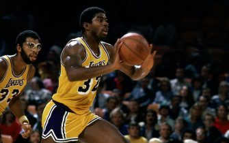 LOS ANGELES - 1981: Magic Johnson #32 of the Los Angeles Lakers moves the ball upcourt during an NBA game at the Forum in Los Angleles, California. NOTE TO USER: User expressly acknowledges  and agrees that, by downloading and or using this  photograph, User is consenting to the terms and conditions of the Getty Images License Agreement.  (Photo by Peter Read Miller/ NBAE/ Getty Images)