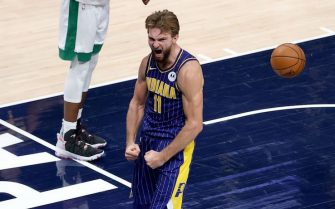 INDIANAPOLIS, INDIANA - DECEMBER 27:   Domantas Sabonis #11 of the Indiana Pacers celebrates after making the game winning shot against the Boston Celtics at Bankers Life Fieldhouse on December 27, 2020 in Indianapolis, Indiana.  NOTE TO USER: User expressly acknowledges and agrees that, by downloading and or using this photograph, User is consenting to the terms and conditions of the Getty Images License Agreement.    (Photo by Andy Lyons/Getty Images)