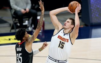 DENVER, COLORADO - DECEMBER 28: Nikola Jokic #15 of the Denver Nuggets puts up a shot over  Christian Wood #35 of the Houston Rockets in the first quarter at Ball Arena on December 28, 2020 in Denver, Colorado. NOTE TO USER: User expressly acknowledges and agrees that, by downloading and or using this photograph, User is consenting to the terms and conditions of the Getty Images License Agreement. (Photo by Matthew Stockman/Getty Images)