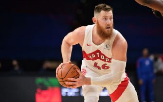PHILADELPHIA, PA - DECEMBER 29: Aron Baynes #46 of the Toronto Raptors handles the ball during the game against the Philadelphia 76ers on December 29, 2020 at the Wells Fargo Center in Philadelphia, Pennsylvania NOTE TO USER: User expressly acknowledges and agrees that, by downloading and/or using this Photograph, user is consenting to the terms and conditions of the Getty Images License Agreement. Mandatory Copyright Notice: Copyright 2020 NBAE (Photo by David Dow/NBAE via Getty Images)