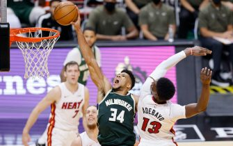 MIAMI, FLORIDA - DECEMBER 30: Giannis Antetokounmpo #34 of the Milwaukee Bucks dunks around Bam Adebayo #13 of the Miami Heat during the third quarter at American Airlines Arena on December 30, 2020 in Miami, Florida. NOTE TO USER: User expressly acknowledges and agrees that, by downloading and or using this photograph, User is consenting to the terms and conditions of the Getty Images License Agreement. (Photo by Michael Reaves/Getty Images)