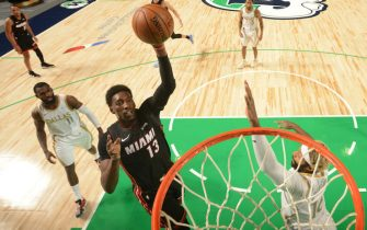DALLAS, TX - JANUARY 1: Bam Adebayo #13 of the Miami Heat shoots the ball on January 1, 2021 at the American Airlines Center in Dallas, Texas. NOTE TO USER: User expressly acknowledges and agrees that, by downloading and or using this photograph, User is consenting to the terms and conditions of the Getty Images License Agreement. Mandatory Copyright Notice: Copyright 2021 NBAE (Photo by Glenn James/NBAE via Getty Images)