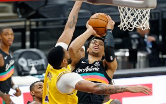 SAN ANTONIO, TX - JANUARY 1:  Keldon Johnson #3 of the San Antonio Spurs #3 shoots over Anthony Davis #3 of the Los Angeles Lakers during first half action at AT&T Center on January 1 , 2021 in San Antonio, Texas.  NOTE TO USER: User expressly acknowledges and agrees that , by downloading and or using this photograph, User is consenting to the terms and conditions of the Getty Images License Agreement. (Photo by Ronald Cortes/Getty Images)