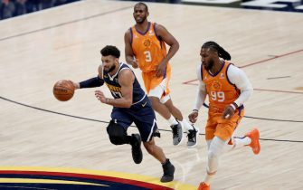 DENVER, COLORADO - JANUARY 01: Jamal Murray #27 of the Denver Nuggets brings the ball down the court against Jae Crowder #99 of the Phoenix Suns after scooping up a lose ball in the third quarter at Ball Arena on January 01, 2021 in Denver, Colorado.  NOTE TO USER: User expressly acknowledges and agrees that, by downloading and or using this photograph, User is consenting to the terms and conditions of the Getty Images License Agreement. (Photo by Matthew Stockman/ Getty Images)