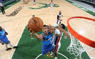 MILWAUKEE, WI - JANUARY 4: Giannis Antetokounmpo #34 of the Milwaukee Bucks drives to the basket during the game against the Detroit Pistons on January 4, 2021 at the Fiserv Forum Center in Milwaukee, Wisconsin. NOTE TO USER: User expressly acknowledges and agrees that, by downloading and or using this Photograph, user is consenting to the terms and conditions of the Getty Images License Agreement. Mandatory Copyright Notice: Copyright 2021 NBAE (Photo by Gary Dineen/NBAE via Getty Images).