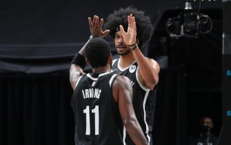 BROOKLYN, NY - JANUARY 5: Kyrie Irving #11 and Jarrett Allen #31 of the Brooklyn Nets hi-five during the game against the Utah Jazz on January 5, 2021 at Barclays Center in Brooklyn, New York. NOTE TO USER: User expressly acknowledges and agrees that, by downloading and or using this Photograph, user is consenting to the terms and conditions of the Getty Images License Agreement. Mandatory Copyright Notice: Copyright 2021 NBAE (Photo by Nathaniel S. Butler/NBAE via Getty Images)