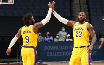 MEMPHIS, TN - JANUARY 5: Wesley Matthews #9 and LeBron James #23 of the Los Angeles Lakers high five during the game against the Memphis Grizzlies on January 5, 2021 at FedExForum in Memphis, Tennessee. NOTE TO USER: User expressly acknowledges and agrees that, by downloading and or using this photograph, User is consenting to the terms and conditions of the Getty Images License Agreement. Mandatory Copyright Notice: Copyright 2021 NBAE (Photo by Joe Murphy/NBAE via Getty Images)