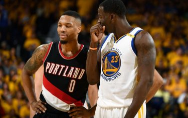 OAKLAND, CA - APRIL 16: Draymond Green #23 of the Golden State Warriors talks with Damian Lillard #0 of the Portland Trail Blazers during the game during the Western Conference Quarterfinals of the 2017 NBA Playoffs on April 16, 2017 at Oracle Arena in Oakland, California. NOTE TO USER: User expressly acknowledges and agrees that, by downloading and or using this photograph, user is consenting to the terms and conditions of Getty Images License Agreement. Mandatory Copyright Notice: Copyright 2017 NBAE (Photo by Garrett Ellwood/NBAE via Getty Images)