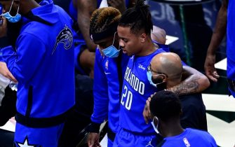 ORLANDO, FLORIDA - JANUARY 06: Markelle Fultz #20 of the Orlando Magic is helped off the court after being injured during the first quarter against the Cleveland Cavaliers at Amway Center on January 06, 2021 in Orlando, Florida. NOTE TO USER: User expressly acknowledges and agrees that, by downloading and or using this photograph, User is consenting to the terms and conditions of the Getty Images License Agreement. (Photo by Douglas P. DeFelice/Getty Images)