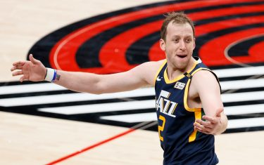 PORTLAND, OREGON - DECEMBER 23: Joe Ingles #2 of the Utah Jazz reacts during the first half of the game against the Portland Trail Blazers at Moda Center on December 23, 2020 in Portland, Oregon. NOTE TO USER: User expressly acknowledges and agrees that, by downloading and or using this photograph, User is consenting to the terms and conditions of the Getty Images License Agreement. (Photo by Steph Chambers/Getty Images)
