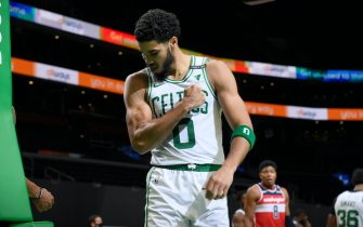 BOSTON, MA - JANUARY 8: Jayson Tatum #0 of the Boston Celtics flexes his muscle during the game against the Washington Wizards on January 8, 2021 at the TD Garden in Boston, Massachusetts.  NOTE TO USER: User expressly acknowledges and agrees that, by downloading and or using this photograph, User is consenting to the terms and conditions of the Getty Images License Agreement. Mandatory Copyright Notice: Copyright 2021 NBAE  (Photo by Brian Babineau/NBAE via Getty Images)