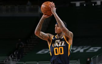 MILWAUKEE, WI - JANUARY 8: Jordan Clarkson #00 of the Utah Jazz shoots the ball against the Milwaukee Bucks on January 8, 2021 at the Fiserv Forum Center in Milwaukee, Wisconsin. NOTE TO USER: User expressly acknowledges and agrees that, by downloading and or using this Photograph, user is consenting to the terms and conditions of the Getty Images License Agreement. Mandatory Copyright Notice: Copyright 2021 NBAE (Photo by Gary Dineen/NBAE via Getty Images).