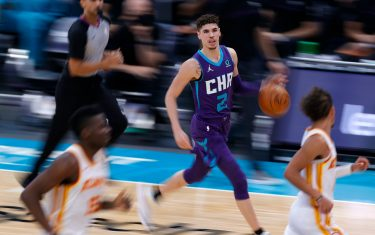 CHARLOTTE, NORTH CAROLINA - JANUARY 09: LaMelo Ball #2 of the Charlotte Hornets brings the ball up court during the third quarter of their game against the Atlanta Hawks at Spectrum Center on January 09, 2021 in Charlotte, North Carolina. NOTE TO USER: User expressly acknowledges and agrees that, by downloading and or using this photograph, User is consenting to the terms and conditions of the Getty Images License Agreement. (Photo by Jared C. Tilton/Getty Images)