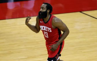 HOUSTON, TEXAS - JANUARY 10: James Harden #13 of the Houston Rockets reacts to a basket during the first quarter of a game against the Los Angeles Lakers at Toyota Center on January 10, 2021 in Houston, Texas. NOTE TO USER: User expressly acknowledges and agrees that, by downloading and or using this photograph, User is consenting to the terms and conditions of the Getty Images License Agreement. (Photo by Carmen Mandato/Getty Images)