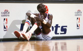 LANDOVER, MD - CIRCA 1986:  Manute Bol #10 of the Washington Bullets sits on the floor waiting to enter an NBA basketball game circa 1986 at the Capital Centre in Landover, Maryland. Bol played for the Bullets from 1985-88. (Photo by Focus on Sport/Getty Images) *** Local Caption *** Manute Bol