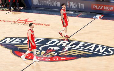 NEW ORLEANS, LA - JANUARY 22: JJ Redick #4, and Lonzo Ball #2 of the New Orleans Pelicans walk on the court during the game against the San Antonio Spurs on January 22, 2020 at Smoothie King Center in New Orleans, Louisiana. NOTE TO USER: User expressly acknowledges and agrees that, by downloading and or using this photograph, User is consenting to the terms and conditions of the Getty Images License Agreement. Mandatory Copyright Notice: Copyright 2020 NBAE (Photo by Jeff Haynes/NBAE via Getty Images)