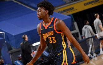 SAN FRANCISCO, CA - JANUARY 27: James Wiseman #33 of the Golden State Warriors looks on during the game against the Minnesota Timberwolves on January 27, 2021 at Chase Center in San Francisco, California. NOTE TO USER: User expressly acknowledges and agrees that, by downloading and or using this photograph, user is consenting to the terms and conditions of Getty Images License Agreement. Mandatory Copyright Notice: Copyright 2021 NBAE (Photo by Noah Graham/NBAE via Getty Images)