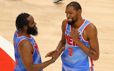ATLANTA, GEORGIA - JANUARY 27:  Kevin Durant #7 and James Harden #13 of the Brooklyn Nets celebrate their 132-128 overtime win over the Atlanta Hawks at State Farm Arena on January 27, 2021 in Atlanta, Georgia.  NOTE TO USER: User expressly acknowledges and agrees that, by downloading and or using this photograph, User is consenting to the terms and conditions of the Getty Images License Agreement.  (Photo by Kevin C. Cox/Getty Images)