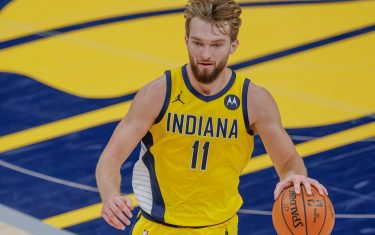 INDIANAPOLIS, IN - DECEMBER 23: Domantas Sabonis #11 of the Indiana Pacers brings the ball up court during the game New York Knicks at Bankers Life Fieldhouse on December 23, 2020 in Indianapolis, Indiana. (Photo by Michael Hickey/Getty Images)