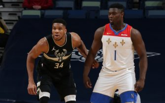 NEW ORLEANS, LA - JANUARY 29: Giannis Antetokounmpo #34 of the Milwaukee Bucks plays defense on Zion Williamson #1 of the New Orleans Pelicans during the game on January 29, 2021 at the Smoothie King Center in New Orleans, Louisiana. NOTE TO USER: User expressly acknowledges and agrees that, by downloading and or using this Photograph, user is consenting to the terms and conditions of the Getty Images License Agreement. Mandatory Copyright Notice: Copyright 2021 NBAE (Photo by Layne Murdoch Jr./NBAE via Getty Images)