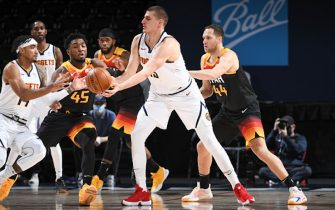 DENVER, CO - JANUARY 31: Nikola Jokic #15 of the Denver Nuggets passes the ball during the game against the Utah Jazz on January 31, 2021 at the Ball Arena in Denver, Colorado. NOTE TO USER: User expressly acknowledges and agrees that, by downloading and/or using this Photograph, user is consenting to the terms and conditions of the Getty Images License Agreement. Mandatory Copyright Notice: Copyright 2021 NBAE (Photo by Garrett Ellwood/NBAE via Getty Images)