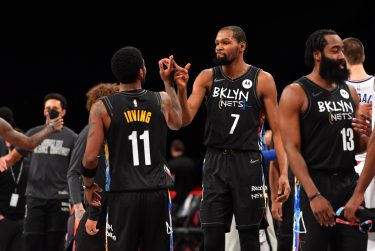 PHILADELPHIA, PA - FEBRUARY 2: Kyrie Irving #11 of the Brooklyn Nets and Kevin Durant #7 of the Brooklyn Nets high-five after a game against the LA Clippers on February 2, 2021 at Barclays Center in Brooklyn, New York. NOTE TO USER: User expressly acknowledges and agrees that, by downloading and/or using this Photograph, user is consenting to the terms and conditions of the Getty Images License Agreement. Mandatory Copyright Notice: Copyright 2021 NBAE (Photo by Jesse D. Garrabrant/NBAE via Getty Images)