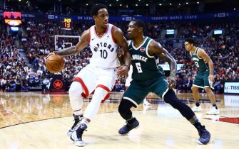 TORONTO, ON - JANUARY 01:  DeMar DeRozan #10 of the Toronto Raptors dribbles the ball as Eric Bledsoe #6 of the Milwaukee Bucks defends during the second half of an NBA game at Air Canada Centre on January 1, 2018 in Toronto, Canada.  NOTE TO USER: User expressly acknowledges and agrees that, by downloading and or using this photograph, User is consenting to the terms and conditions of the Getty Images License Agreement.  (Photo by Vaughn Ridley/Getty Images)