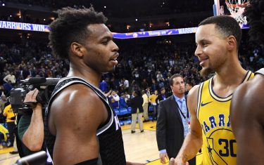 OAKLAND, CA - FEBRUARY 21:  Buddy Hield #24 of the Sacramento Kings greets Stephen Curry #30 of the Golden State Warriors after the game on February 21, 2019 at ORACLE Arena in Oakland, California. NOTE TO USER: User expressly acknowledges and agrees that, by downloading and or using this photograph, user is consenting to the terms and conditions of Getty Images License Agreement. Mandatory Copyright Notice: Copyright 2019 NBAE (Photo by Noah Graham/NBAE via Getty Images)