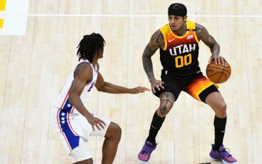 SALT LAKE CITY, UTAH - FEBRUARY 15:  Jordan Clarkson #00 of the Utah Jazz attempts to drive around Tyrese Maxey #0 of the Philadelphia 76ers during a game at Vivint Smart Home Arena on February 15, 2021 in Salt Lake City, Utah. NOTE TO USER: User expressly acknowledges and agrees that, by downloading and/or using this photograph, user is consenting to the terms and conditions of the Getty Images License Agreement.  (Photo by Alex Goodlett/Getty Images)