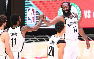 LOS ANGELES, CA - FEBRUARY 21: Brooklyn Nets Guard James Harden (13) and Guard Kyrie Irving (11) give high fives in the final minute of a NBA game between the Brooklyn Nets and the Los Angeles Clippers on February 21, 2021 at STAPLES Center in Los Angeles, CA. The game was played without fans due to the COVID-19 pandemic. (Photo by Brian Rothmuller/Icon Sportswire via Getty Images)