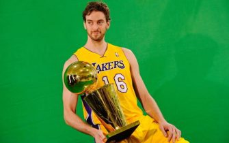 EL SEGUNDO, CA - SEPTEMBER 25:  Pau Gasol #16 of the Los Angeles Lakers poses for a photograph with the NBA Finals Larry O'Brien Championship Trophy during Media Day at the Toyota Center on September 25, 2010 in El Segundo, California. NOTE TO USER: User expressly acknowledges and agrees that, by downloading and/or using this Photograph, user is consenting to the terms and conditions of the Getty Images License Agreement.  (Photo by Kevork Djansezian/Getty Images)