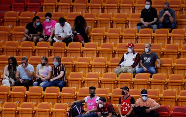 MIAMI, FLORIDA - FEBRUARY 24: Fans look on during the fourth quarter between the Miami Heat and the Toronto Raptors at American Airlines Arena on February 24, 2021 in Miami, Florida. NOTE TO USER: User expressly acknowledges and agrees that, by downloading and or using this photograph, User is consenting to the terms and conditions of the Getty Images License Agreement.  (Photo by Michael Reaves/Getty Images)