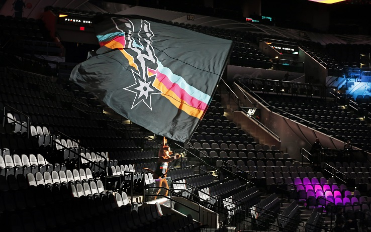 SAN ANTONIO, TX - JANUARY 1:  With Covid not allowing fans yet Coyote mascot for the San Antonio Spurs goes into the empty stands during their team introduction against the Los Angeles Lakers at AT&T Center on January 1, 2021 in San Antonio, Texas.  NOTE TO USER: User expressly acknowledges and agrees that , by downloading and or using this photograph, User is consenting to the terms and conditions of the Getty Images License Agreement. (Photo by Ronald Cortes/Getty Images)