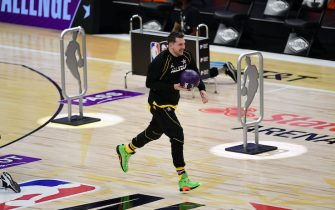 ATLANTA, GA - MARCH 7: Luka Doncic #77 of Team LeBron dribbles the ball during the Taco Bell Skills Challenge as part of 2021 NBA All Star Weekend on March 7, 2021 at State Farm Arena in Atlanta, Georgia. NOTE TO USER: User expressly acknowledges and agrees that, by downloading and or using this photograph, User is consenting to the terms and conditions of the Getty Images License Agreement. Mandatory Copyright Notice: Copyright 2021 NBAE (Photo by Adam Hagy/NBAE via Getty Images)
