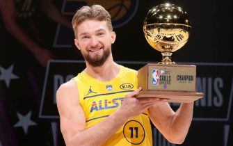 ATLANTA, GA - MARCH 7:  Domantas Sabonis #11 of Team LeBron holds the Taco Bell Skills Challenge trophy during the Taco Bell Skills Challenge as part of 2021 NBA All Star Weekend on March 7, 2021 at State Farm Arena in Atlanta, Georgia. NOTE TO USER: User expressly acknowledges and agrees that, by downloading and or using this photograph, User is consenting to the terms and conditions of the Getty Images License Agreement. Mandatory Copyright Notice: Copyright 2021 NBAE (Photo by Nathaniel S. Butler/NBAE via Getty Images)