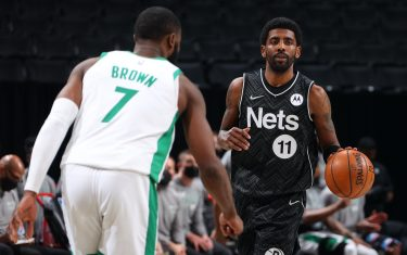 BROOKLYN, NY - MARCH 11: Kyrie Irving #11 of the Brooklyn Nets dribbles the ball during the game against the Boston Celtics on March 11, 2021 at Barclays Center in Brooklyn, New York. NOTE TO USER: User expressly acknowledges and agrees that, by downloading and or using this Photograph, user is consenting to the terms and conditions of the Getty Images License Agreement. Mandatory Copyright Notice: Copyright 2021 NBAE (Photo by Ned Dishman/NBAE via Getty Images)