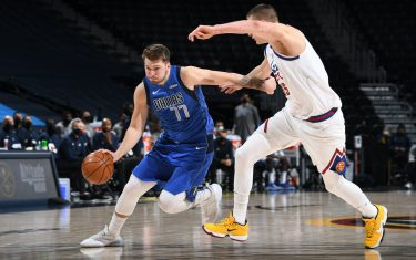 DENVER, CO - MARCH 13: Luka Doncic #77 of the Dallas Mavericks dribbles the ball during the game against the Denver Nuggets on March 13, 2021 at the Ball Arena in Denver, Colorado. NOTE TO USER: User expressly acknowledges and agrees that, by downloading and/or using this Photograph, user is consenting to the terms and conditions of the Getty Images License Agreement. Mandatory Copyright Notice: Copyright 2021 NBAE (Photo by Garrett Ellwood/NBAE via Getty Images)