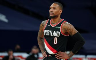 MINNEAPOLIS, MN -  MARCH 14: Damian Lillard #0 of the Portland Trail Blazers looks on during the game against the Minnesota Timberwolves on March 14, 2021 at Target Center in Minneapolis, Minnesota. NOTE TO USER: User expressly acknowledges and agrees that, by downloading and or using this Photograph, user is consenting to the terms and conditions of the Getty Images License Agreement. Mandatory Copyright Notice: Copyright 2021 NBAE (Photo by Jordan Johnson/NBAE via Getty Images)