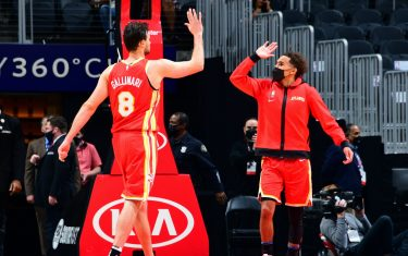 ATLANTA, GA - MARCH 14: Trae Young #11 hi-fives Danilo Gallinari #8 of the Atlanta Hawks during the game against the Cleveland Cavaliers on March 14, 2021 at State Farm Arena in Atlanta, Georgia.  NOTE TO USER: User expressly acknowledges and agrees that, by downloading and/or using this Photograph, user is consenting to the terms and conditions of the Getty Images License Agreement. Mandatory Copyright Notice: Copyright 2021 NBAE (Photo by Scott Cunningham/NBAE via Getty Images)