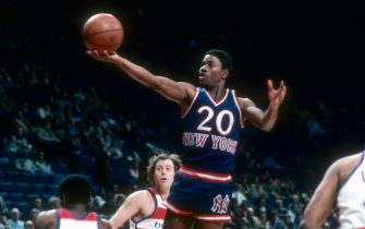 LANDOVER, MD - CIRCA 1980: Michael Ray Richardson #20 of the New York Knicks shoots over Kevin Porter #1 of the Washington Bullets during an NBA basketball game circa 1980 at the Capital Centre in Landover, Maryland. Richardson played for the Knicks from 1978-82. (Photo by Focus on Sport/Getty Images) *** Local Caption *** Michael Ray Richardson; Kevin Porter