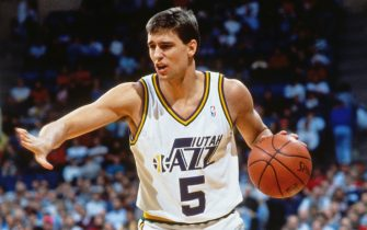 SALT LAKE CITY, UT - 1991: Andy Toolson #5 of the Utah Jazz dribbles during a game played circa 1991 at the Salt Palace in Salt Lake City, Utah. NOTE TO USER: User expressly acknowledges and agrees that, by downloading and or using this photograph, User is consenting to the terms and conditions of the Getty Images License Agreement. Mandatory Copyright Notice: Copyright 1991 NBAE (Photo by Andrew D. Bernstein/NBAE via Getty Images)