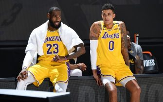 ORLANDO, FL - AUGUST 29: LeBron James #23 and Kyle Kuzma #0 of the Los Angeles Lakers watches the game from the sidelines during Round One, Game Five of the NBA Playoffs on August 29, 2020 at AdventHealth Arena in Orlando, Florida. NOTE TO USER: User expressly acknowledges and agrees that, by downloading and/or using this Photograph, user is consenting to the terms and conditions of the Getty Images License Agreement. Mandatory Copyright Notice: Copyright 2020 NBAE (Photo by Andrew D. Bernstein/NBAE via Getty Images)