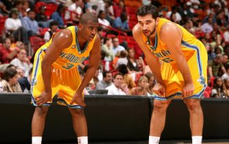 MIAMI - OCTOBER 17:  Chris Paul #3 and Peja Stojakovic #16 of the New Orleans/Oklahoma City Hornets take a breather against the Miami Heat on October 17, 2006 at American Airlines Arena in Miami, Florida. NOTE TO USER: User expressly acknowledges and agrees that, by downloading and/or using this Photograph, User is consenting to the terms and conditions of the Getty Images License Agreement. Mandatory copyright notice: Copyright NBAE 2006 (Photo by Victor Baldizon/NBAE via Getty Images)