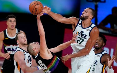 LAKE BUENA VISTA, FLORIDA - AUGUST 19: Rudy Gobert #27 of the Utah Jazz blocks a shot by Nikola Jokic #15 of the Denver Nuggets during the first half of Game Two of a first round playoff game at AdventHealth Arena at ESPN Wide World Of Sports Complex on August 19, 2020 in Lake Buena Vista, Florida. NOTE TO USER: User expressly acknowledges and agrees that, by downloading and or using this photograph, User is consenting to the terms and conditions of the Getty Images License Agreement.  (Photo by Ashley Landis-Pool/Getty Images)