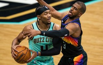 CHARLOTTE, NORTH CAROLINA - MARCH 28: Devonte' Graham #4 of the Charlotte Hornets is guarded by Chris Paul #3 of the Phoenix Suns during the first quarter during their game at Spectrum Center on March 28, 2021 in Charlotte, North Carolina. NOTE TO USER: User expressly acknowledges and agrees that, by downloading and or using this photograph, User is consenting to the terms and conditions of the Getty Images License Agreement. (Photo by Jacob Kupferman/Getty Images)