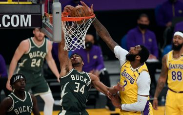 LOS ANGELES, CA - MARCH 31: Giannis Antetokounmpo #34 of the Milwaukee Bucks scores a basket against Andre Drummond #2 of the Los Angeles Lakers during the first half of the game at Staples Center on March 31, 2021 in Los Angeles, California. NOTE TO USER: User expressly acknowledges and agrees that, by downloading and or using this photograph, User is consenting to the terms and conditions of the Getty Images License Agreement. (Photo by Kevork Djansezian/Getty Images)