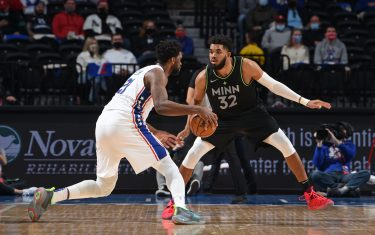PHILADELPHIA, PA - APRIL 3: Karl-Anthony Towns #32 of the Minnesota Timberwolves plays defense against Joel Embiid #21 of the Philadelphia 76ers on April 3, 2021 at Wells Fargo Center in Philadelphia, Pennsylvania. NOTE TO USER: User expressly acknowledges and agrees that, by downloading and/or using this Photograph, user is consenting to the terms and conditions of the Getty Images License Agreement. Mandatory Copyright Notice: Copyright 2021 NBAE (Photo by David Dow/NBAE via Getty Images)