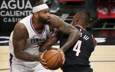 LOS ANGELES, CALIFORNIA - APRIL 06: DeMarcus Cousins #15 of the LA Clippers handles the ball defended by Harry Giles III #4 of the Portland Trail Blazers at Staples Center on April 06, 2021 in Los Angeles, California. NOTE TO USER: User expressly acknowledges and agrees that, by downloading and or using this photograph, User is consenting to the terms and conditions of the Getty Images License Agreement. (Photo by Meg Oliphant/Getty Images)
